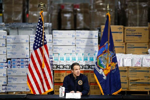 (AP Photo/John Minchillo). FILE - In this Tuesday, March 24, 2020 file photo, Gov. Andrew Cuomo speaks during a news conference against a backdrop of medical supplies at the Jacob Javits Center that will house a temporary hospital in response to the CO...
