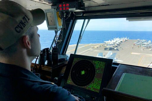 (AP Photo/Jim Gomez, File). FILE - In this April 10, 2018, file photo, a U.S. Navy crewman monitors on the deck of the U.S. aircraft carrier Theodore Roosevelt in international waters off South China Sea. The USS Theodore Roosevelt made the second-ever...