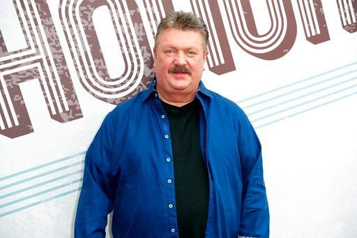 (Photo by Al Wagner/Invision/AP, File). FILE - This Aug. 22, 2018 file photo shows Joe Diffie at the 12th annual ACM Honors in Nashville, Tenn. A publicist for Diffie says the country singer has tested positive for COVID-19. Diffie is under the care of...