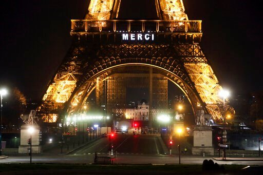 """(AP Photo/Thibault Camus). The word """"Merci"""", the French word for 'Thank you"""", is emblazoned on the Eiffel Tower as France's coronavirus death toll continued to climb, in Paris, Friday, March 27, 2020. Health workers fighting to save lives in France fro..."""