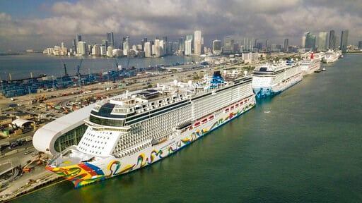 (Al Diaz/Miami Herald via AP). The Norwegian Encore cruise ship is docked at the Port of Miami on Thursday, March 26, 2020, in Miami, Fla.