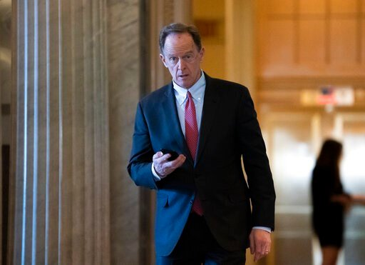 (AP Photo/J. Scott Applewhite, File). FILE - In this Feb. 3, 2020, file photo, Sen. Pat Toomey, R-Pa., walks at the Capitol in Washington. The nation's fiercest fiscal conservatives are largely embracing the massive economic rescue package moving throu...
