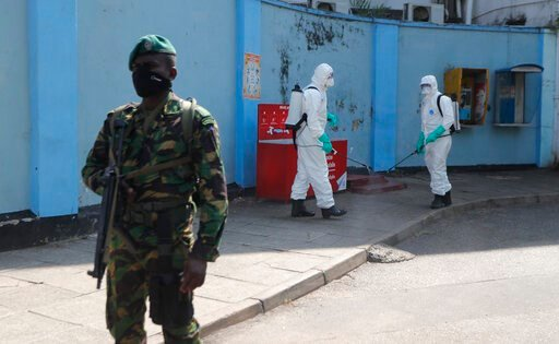 (AP Photo/Eranga Jayawardena). Sri Lankan police commandos prepare to spray disinfectants in a hospital in Colombo, Sri Lanka, Friday, March 27, 2020. The new coronavirus causes mild or moderate symptoms for most people, but for some, especially older ...