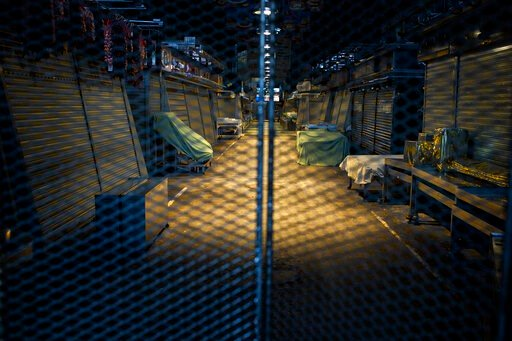 (AP Photo/Emilio Morenatti). A view of La Boqueria market closed down in downtown Barcelona, Spain, Thursday, March 26, 2020. The new coronavirus causes mild or moderate symptoms for most people, but for some, especially older adults and people with ex...