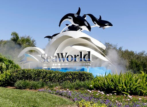 (AP Photo/John Raoux, File). FILE - This Jan. 31, 2017, file photo, shows the entrance to SeaWorld, in Orlando, Fla. SeaWorld Entertainment is furloughing 90% of its workers because the novel coronavirus had forced the company to close its 12 theme par...