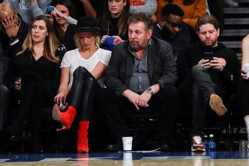 (AP Photo/Frank Franklin II). New York Knicks owner James Dolan, center, reacts with fans during the second half of the team's NBA basketball game against the Memphis Grizzlies on Wednesday, Jan. 29, 2020, in New York. The Grizzlies won 127-106.