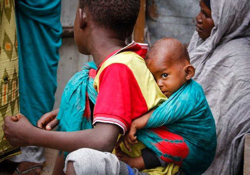 (AP Photo/Farah Abdi Warsameh). In this photo taken Thursday, March 26, 2020, residents live in crowded conditions in the Sayidka camp for internally displaced people in Mogadishu, Somalia. The country has only a handful of confirmed cases of the new c...