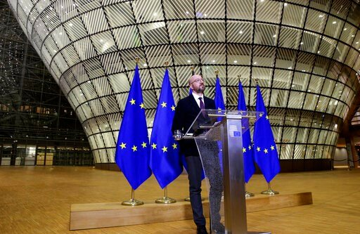 (Francois Walschaerts, Pool Photo via AP). European Council President Charles Michel speaks during a media conference after an EU summit by video conference in Brussels, Thursday, March 26, 2020. Following the informal video conference, members of the ...