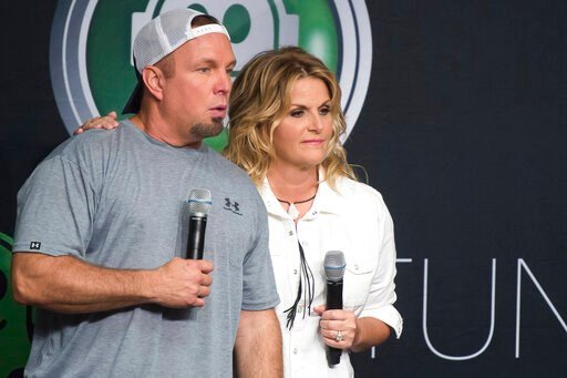 (Photo by Charles Sykes/Invision/AP, File). FILE - In a Friday, July 8, 2016 file photo, Garth Brooks and Trisha Yearwood attend a news conference at Yankee Stadium, in New York. CBS said Sunday, March 29, 2020, that it will air a live prime-time speci...