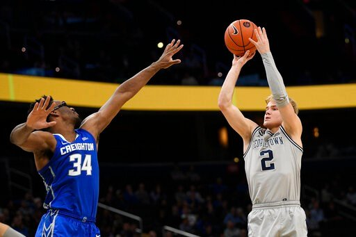 (AP Photo/Nick Wass). Georgetown guard Mac McClung (2) shoots as he is defended by Creighton guard Denzel Mahoney (34) during the second half of an NCAA college basketball game, Wednesday, Jan. 15, 2020, in Washington. Georgetown won 83-80.