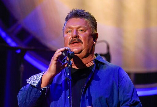 (Photo by Al Wagner/Invision/AP, File). FILE - This Aug. 22, 2018 file photo shows Joe Diffie performing at the 12th annual ACM Honors in Nashville, Tenn. A publicist for Diffie says the country singer has tested positive for COVID-19. Diffie is under ...
