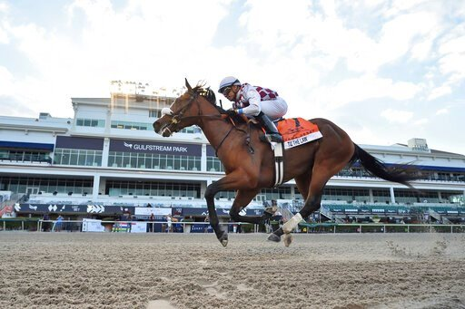 (Lauren King/Coglianese Photos, Gulfstream Park via AP). In this image provided by Gulfstream Park, Tiz the Law, riddren by Manuel Franco, wins the Florida Derby horse race at Gulfstream Park, Saturday, March 28, 2020, in Hallandale Beach, Fla.