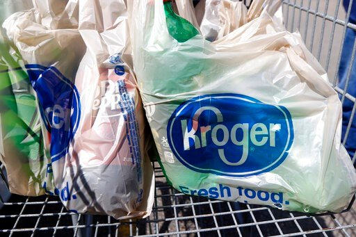 (AP Photo/Rogelio V. Solis, File). FILE - In this June 15, 2017, file photo, bagged purchases from the Kroger grocery store in Flowood, Miss., sit inside this shopping cart. A group of Instacart workers are organizing a strike across the U.S. starting ...