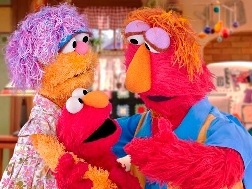 (Sesame Workshop via AP). This undated image provided by Sesame Workshop shows Elmo and his parents Louie and Mae. Sesame Workshop announced Monday, March 30, 2020, that Elmo, Rooster and Cookie Monster are featured in some of four new animated public ...