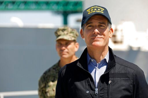 (Carolyn Cole/Los Angeles Times via AP, Pool). Los Angeles Mayor Eric Garcetti listens as California Governor Gavin Newsom speaks in front of the hospital ship US Naval Ship Mercy that arrived into the Port of Los Angeles on Friday, March 27, 2020, to ...