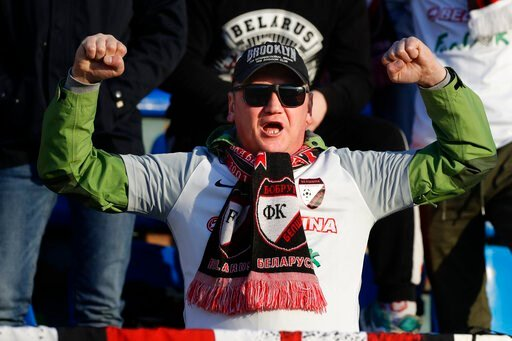 (AP Photo/Sergei Grits). In this photo taken on Friday, March 27, 2020, a fan of Belshina Bobruisk team cheers during the Belarus Championship soccer match between Torpedo-BelAZ Zhodino and Belshina Bobruisk in the town of Zhodino, Belarus. Longtime Be...
