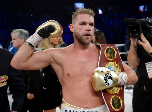 (Ryan Remiorz/The Canadian Press via AP). FILE - In this Dec. 16, 2017, file photo, Billy Joe Saunders, of Britain, celebrates his win over David Lemieux, of Canada, to retain the WBO middleweight boxing title in Laval, Quebec. Saunders had his boxing ...