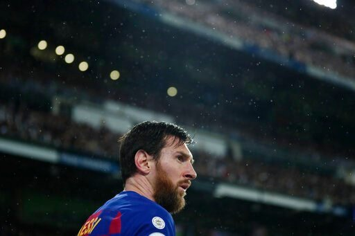 (AP Photo/Manu Fernandez). Barcelona's Lionel Messi attends the Spanish La Liga soccer match between Real Madrid and Barcelona at the Santiago Bernabeu stadium in Madrid, Spain, Sunday, March 1, 2020.