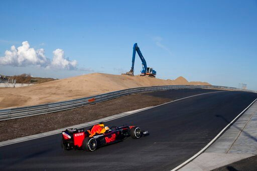 (AP Photo/Peter Dejong). F1 driver Max Verstappen of The Netherlands drives his car through one of the two banked corners during a test and official presentation of the renovated F1 track in the beachside resort of Zandvoort, western Netherlands, Wedne...