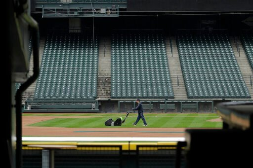 (AP Photo/Ted S. Warren). A grounds crew worker cuts the infield in front of empty seats at T-Mobile Park in Seattle, Thursday, March 26, 2020, around the time when the first pitch would have been thrown in the Mariners' Opening Day baseball game again...