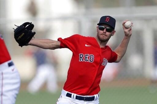 (AP Photo/John Bazemore). Boston Red Sox starting pitcher Chris Sale throws during spring training baseball camp Wednesday, Feb. 19, 2020, in Sarasota, Fla.