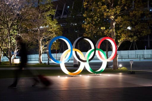 (AP Photo/Jae C. Hong). The Olympic rings are seen Monday, March 30, 2020, in Tokyo. The Tokyo Olympics will open next year in the same time slot scheduled for this year's games. Tokyo organizers said Monday the opening ceremony will take place on July...