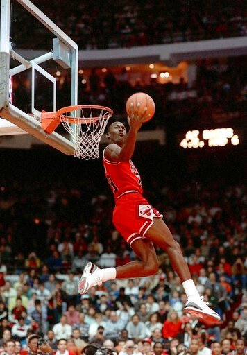 (AP Photo/John Swart). FILE - In this Feb. 6, 1988, file photo, Chicago Bulls' Michael Jordan dunks during the slam-dunk competition of the NBA All-Star weekend in Chicago.  Jordan left the old Chicago Stadium that night with the trophy. To this day, m...