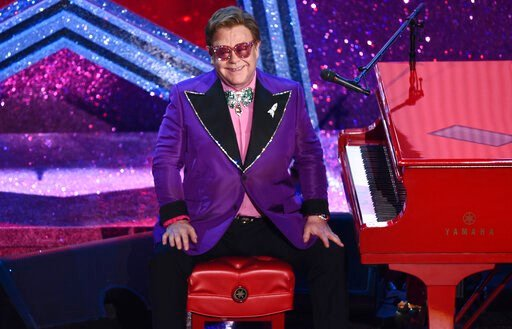 """(AP Photo/Chris Pizzello, File). FILE - In this Sunday, Feb. 9, 2020, file photo, Elton John appears after performing his nominated song, """"(I'm Gonna) Love Me Again,"""" at the Oscars in Los Angeles. The Elton John-led starry benefit concert that featured..."""