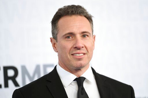 (Photo by Evan Agostini/Invision/AP, File). FILE - This May 15, 2019 file photo shows CNN news anchor Chris Cuomo at the WarnerMedia Upfront in New York. Cuomo has announced that he has tested positive for the coronavirus. The prime-time host is one of...