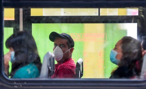 "(AP Photo / Eduardo Verdugo). Commuters wear masks as they ride a bus, to prevent the spread of the new coronavirus in Mexico City, Tuesday, March 31, 2020. Mexico's government has broadened its shutdown of ""non essential activities,"" and prohibited ga..."