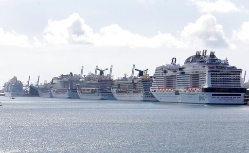 (AP Photo/Wilfredo Lee). Cruise ships are docked at PortMiami, Tuesday, March 31, 2020, in Miami.