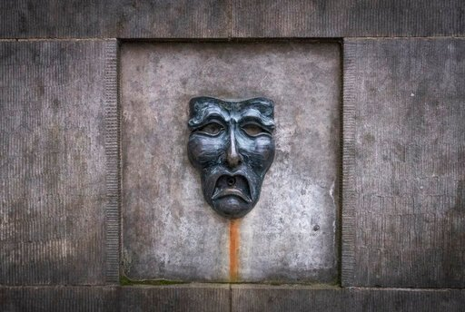 (Jane Barlow/PA via AP). A bronze theatre mask on Edinburgh's Royal Mile, in Edinburgh, Scotland,  Wednesday April 1, 2020. Every August, the Scottish capital of Edinburgh plays host to some of the funniest and talented — not to forget the strangest — ...