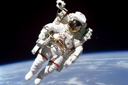 (NASA via AP). In this Feb. 7, 1984 photo made available by NASA, astronaut Bruce McCandless II, performs a spacewalk a few meters away from the cabin of the Earth-orbiting space shuttle Challenger, using a nitrogen-propelled Manned Maneuvering Unit. O...