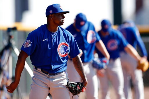 (AP Photo/Gregory Bull). Chicago Cubs pitcher Jharel Cotton, left, throws alongside other pitchers during a spring training baseball workout Wednesday, Feb. 12, 2020, in Mesa, Ariz.