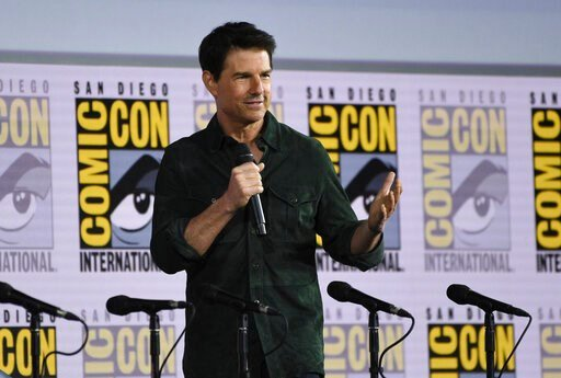 "(Photo by Chris Pizzello/Invision/AP, File). FILE - This July 18, 2019 file photo shows Tom Cruise presenting a clip from ""Top Gun: Maverick"" on day one of Comic-Con International in San Diego. Paramount Pictures announced on Thursday, April 2,  that ""..."