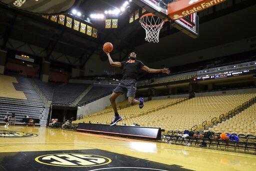 (Alex de la Osa/UAA Communications via AP). In this Jan. 10, 2020, photo provided by the University of Florida Athletic Association, University of Florida team manager Chris Sutherland is shown warming up before a game between Florida team managers and...