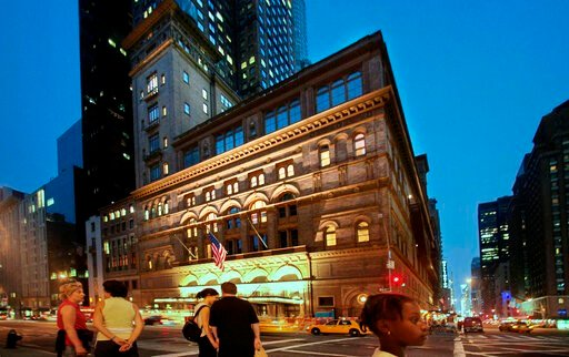 (AP Photo/Bebeto Matthews). FILE - In this Aug. 3, 2007 file photo, the Carnegie Hall building at 57th St. and Broadway appears in New York. Carnegie Hall is projecting a $9 million operating deficit on its $104 million budget after canceling the rest ...