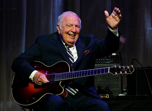 "(AP Photo/Rich Schultz, File). FILE - This June 5, 2011 file photo shows jazz great John ""Bucky"" Pizzarelli after being inducted into the New Jersey Hall of Fame during the induction ceremony in Newark, N.J. The virtuoso who performed mostly modern int..."