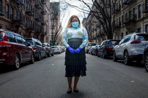 (AP Photo/Marshall Ritzell). Tiffany Pinckney poses for a portrait in the Harlem neighborhood of New York on April 1, 2020. After a period of quarantine at home separated from her children, she has recovered from COVID-19. Pinckney became one of the na...