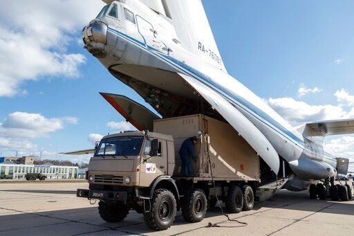 (Alexei Yereshko, Russian Defense Ministry Press Service via AP). FILE - In this March 22, 2020 file photo distributed by Russian Defense Ministry Press Service, a military truck loads medical supplies for Italy on a board of an Il-76 cargo plane in Ch...