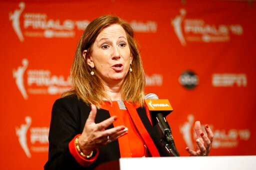 (AP Photo/Patrick Semansky, File). FILE - In this Sept. 29, 2019, file photo, WNBA Commissioner Cathy Engelbert speaks at a news conference before Game 1 of basketball's WNBA Finals between the Connecticut Sun and the Washington Mystics, in Washington....