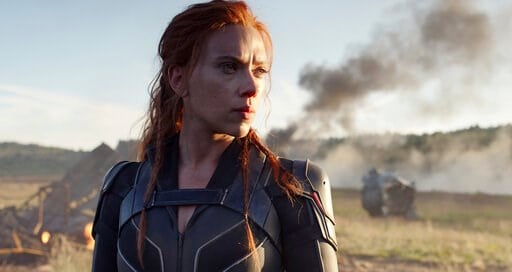 "(Marvel Studios/Disney via AP). This image released by Disney/Marvel Studios' shows Scarlett Johansson in a scene from ""Black Widow."" The Walt Disney Co. on Friday overhauled its release schedule, moving the dates of half a dozen Marvel movies. ""Black ..."