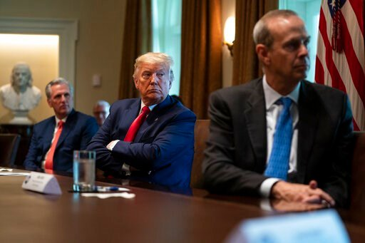 (AP Photo/Evan Vucci). House Minority Leader Kevin McCarthy of Calif., President Donald Trump, and Chevron CEO Mike Wirth listen during a meeting with energy sector business leaders in the Cabinet Room of the White House, Friday, April 3, 2020, in Wash...