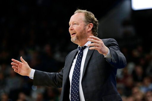 (AP Photo/Eric Gay, File). FILE - In this Jan. 6, 2020, file photo, Milwaukee Bucks head coach Mike Budenholzer reacts to a call during the first half of an NBA basketball game against the San Antonio Spurs in San Antonio. The NBA-leading Bucks remain ...