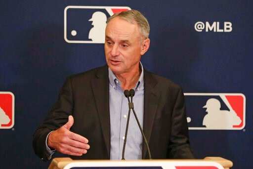 (AP Photo/John Raoux). MLB Commissioner Rob Manfred answers questions at a press conference during MLB baseball owners meetings, Thursday, Feb. 6, 2020, in Orlando, Fla.