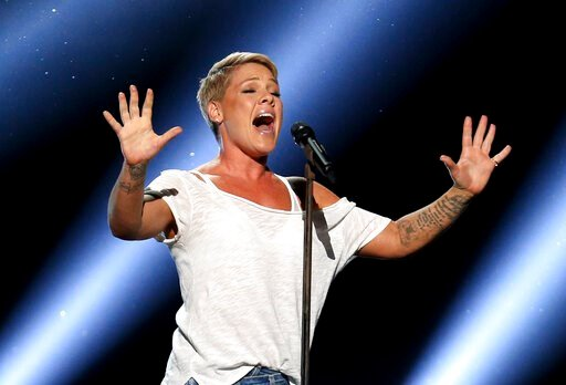 "(Photo by Matt Sayles/Invision/AP, File). FILE - In this Jan. 28, 2018, file photo, Pink performs ""Wild Hearts Can't Be Broken"" at the 60th annual Grammy Awards at Madison Square Garden in New York. Pink says she had COVID-19 and is donating $500,000 e..."