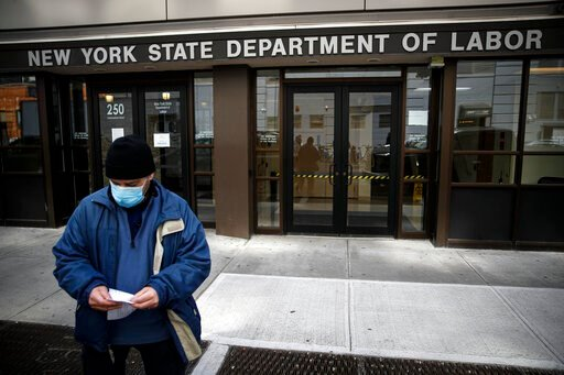 (AP Photo/John Minchillo, File). FILE - In this Wednesday, March 18, 2020 file photo, Visitors to the Department of Labor are turned away at the door by personnel due to closures over coronavirus concerns in New York. Americans are seeking unemployment...