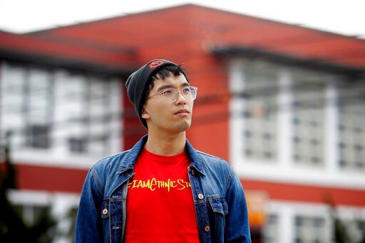 (AP Photo/Jeff Chiu). In this March 31, 2020, photo, Kyle Navarro poses in San Francisco. The school nurse was recently unlocking his bicycle when an older white man called him a racial slur and spat at him. Asian Americans are using social media to or...