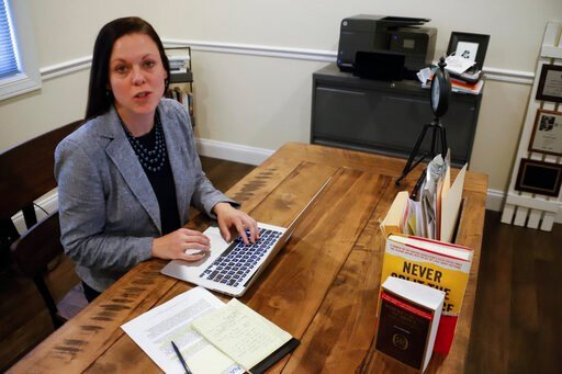 (AP Photo/Keith Srakocic). In this photo made on, April 2, 2020, nurse anesthetist Jessica Poole checks for updates on the coronavirus pandemic in her home office in Greensburg, Pa. Poole, until a couple weeks ago, worked for a private anesthesia pract...
