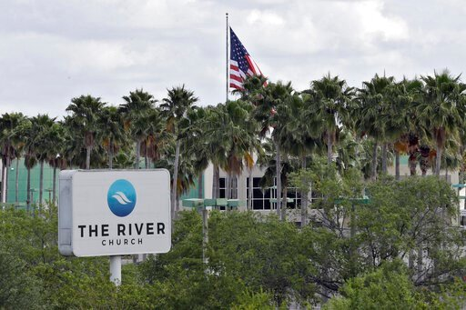 (AP Photo/Chris O'Meara). FILE - This Monday, March 30, 2020 file photo shows The River Church in Tampa, Fla. Pastor Rodney Howard-Browne was arrested Monday, March 30, 2020, for violating a county order by hosting a large number of congregants at the ...